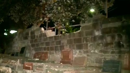 The car ploughed into a wall at the cemetery. (9NEWS)