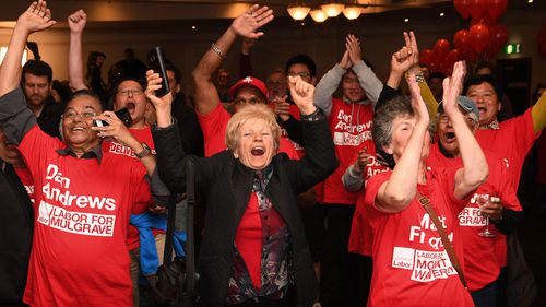 Labor supporters pictured during last night's victory.