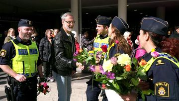 9RAW: People of Stockholm offer 'loving' tribute to terror victims and police