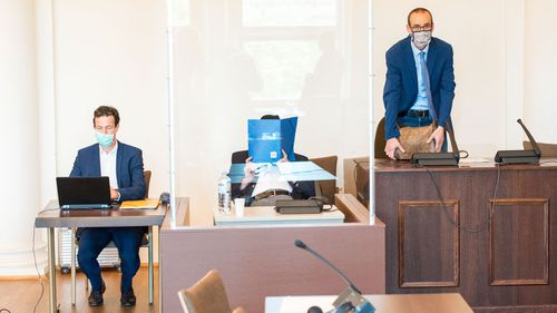 Bruno Dey, 93-year-old former SS security guard from the Stutthof concentration camp near Gdansk sits in a courtroom behind a plexiglass window next to his lawyer Stefan Waterkamp (R) and a doctor (L) in the regional court on July 23, 2020 in Hamburg, Germany.