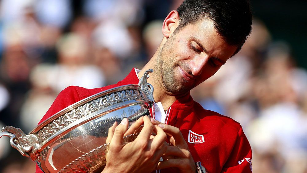 Djokovic joins greats with French Open win