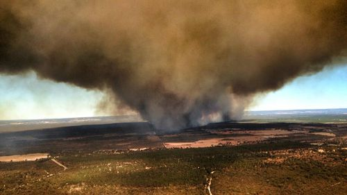 Warnings downgraded, residents urged to remain vigilant as bushfires rage north-east of Perth