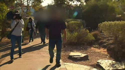The father-of-four lashed out at reporters as he left court today. (9NEWS)