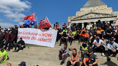 CFMEU members and other people angry about mandatory vaccinations and lockdowns form a protest at the Shrine of Remembrance.