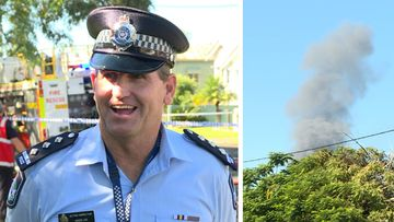 A fire has erupted behind a police officer while he was talking to a news crew about an unrelated deadly fire.