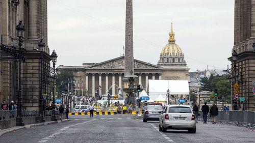 Police open fire after car tries to ram Tour de France barrier