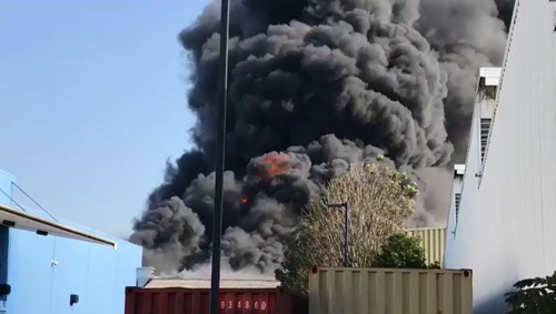 The large fire is producing vast plumes of smoke at the Virginia workshop. (9NEWS)