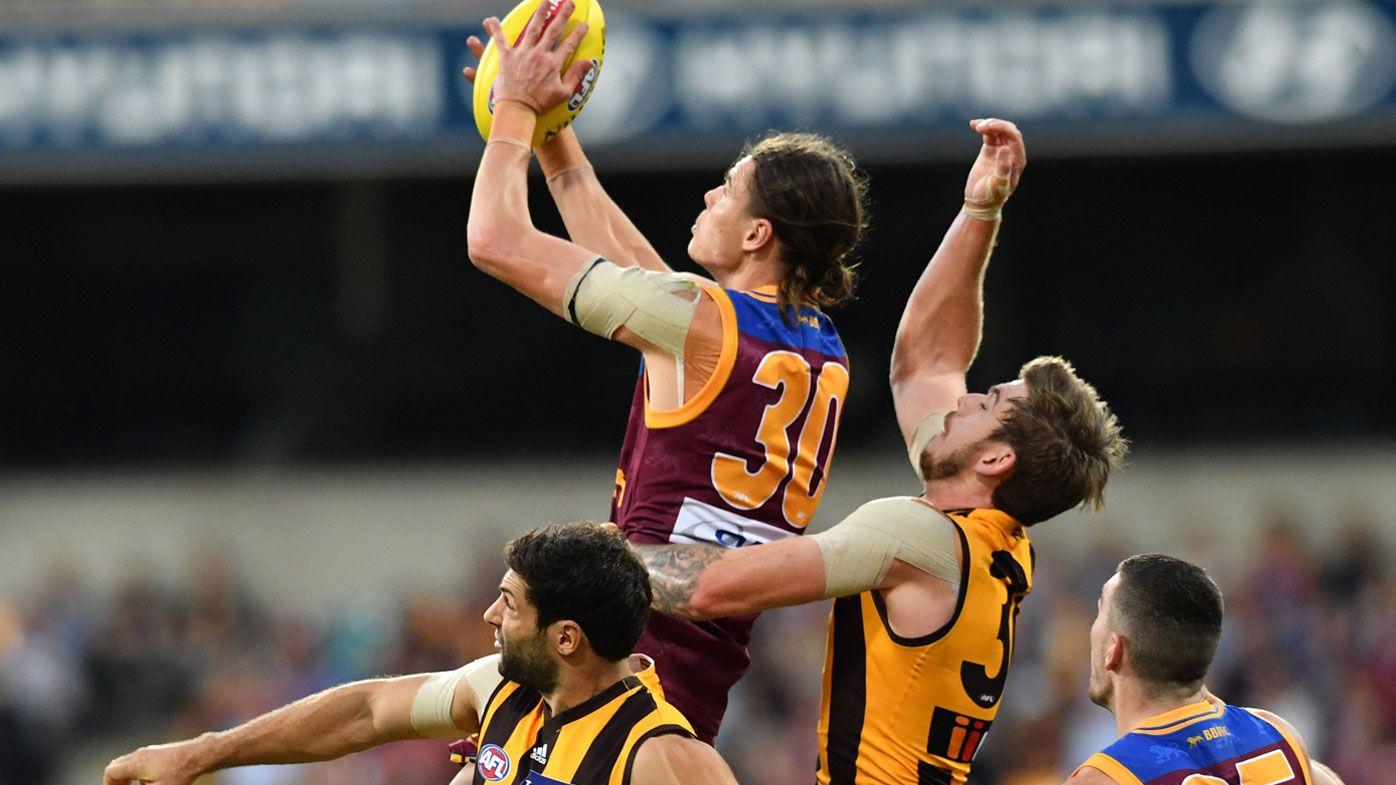Hodge's Lions topple Hawks in AFL upset
