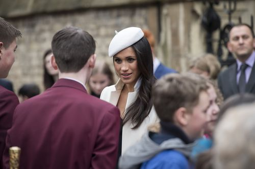 Meghan took time to engage in conversation with schoolchildren in Dean's Yard, in the Abbey surrounds. Picture: PA/AAP