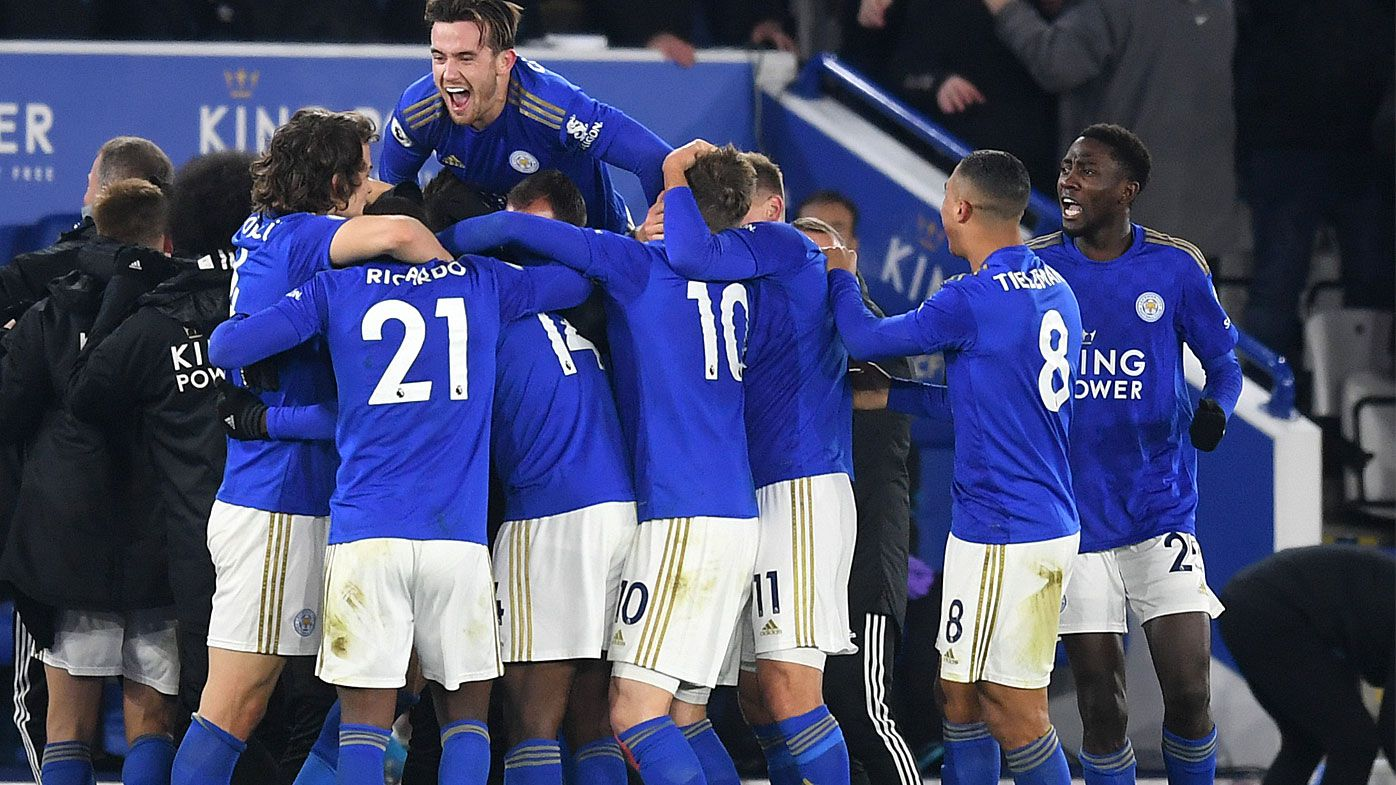 Kelechi Iheanacho of Leicester City celebrates with his team mates after he scores his sides 2nd goal during the Premier League match