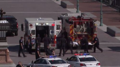 The suspect being loaded into an ambulance. (NBC)