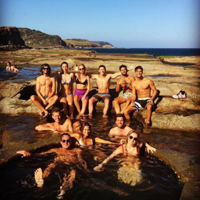 Clint's son Scott Eastwood, who is filming <em>Pacific Rim</em>'s sequel in Oz, enjoyed a day off at the Figure 8 Pools in the Royal National Park (he's in the centre)