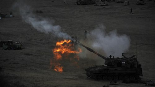 An Israeli tank fires a shell during the latest round of violence. (Getty)