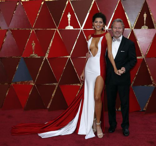 She stepped out on the red carpet today with partner John Savage. (AAP)