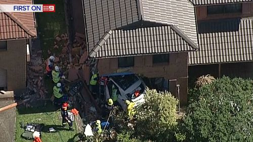 A car has crashed into a house at Carlingford, in Sydney's north west. (9NEWS)