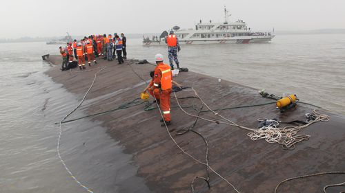 Rescuers race against clock to find survivors of Chinese ship