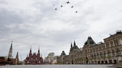 bombers, Tu-160, right, and Tu-22M3, all others, fly over almost empty Red Square in Moscow, Russia, Monday, May 4, 2020. The Russian air force conducted a rehearsal of the flyover intended to mark the 75th anniversary of the victory over the Nazis on May 9, but the planned military parade is postponed due to the coronavirus outbreak, leaving only the flyby. (AP Photo/Alexander Zemlianichenko)
