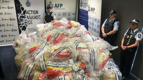 Eight men were charged after a record 1.2 tonnes of meth worth more than $1 billion was seized in December last year. (AAP)