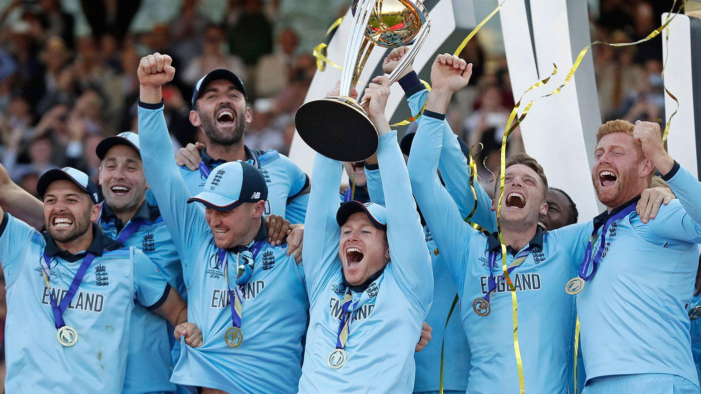 England captain Eoin Morgan lifts the World Cup trophy.