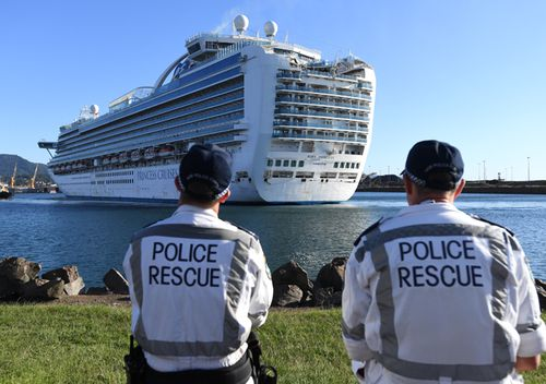 NSW Police Rescue officers look on as the Ruby Princess, with 1040 crew  onboard, docks at Port Kembla, Wollongong.