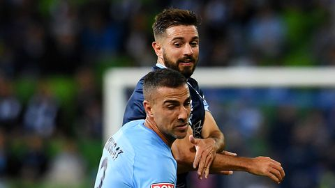 Emmanuel Muscat of Melbourne City is tackled by Michael Zullo of Sydney FC