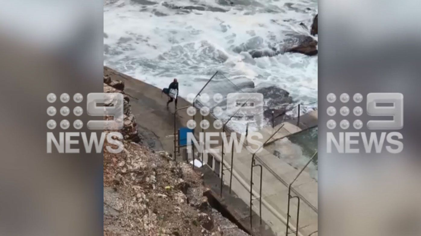 11-time world champion Kelly Slater snaps board in huge swell off Sydney's Avalon Beach
