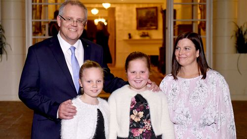 Mr Morrison and his family at Government House last night.
