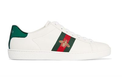 "It's all in the details. These luxe leather low-tops feature a textured metallic snake-print heel patch and an embroidered gold bee, Gucci designer Alessandro Michele's style signature. They'll command attention dashing between meetings, and work back with off-duty wear.<br> Gucci watersnake-trimmed leather sneakers, $640. <a href=""https://www.net-a-porter.com/au/en/product/714176/Gucci/watersnake-trimmed-leather-sneakers"" target=""_blank"">Netaporter.com<br> </a>"