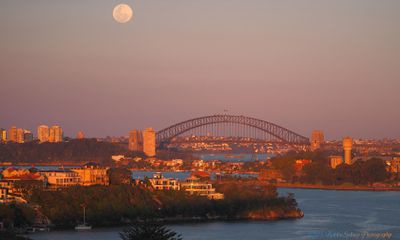 The supermoon from Sydney Harbour this morning. (Supplied: Robbie Sydney Photography)