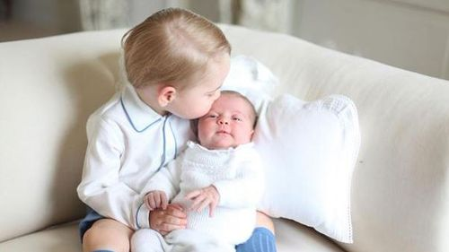 First photos of Princess Charlotte with Prince George released by royal family
