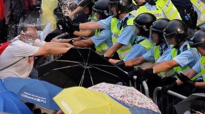Hong Kong protesters who've taken over the city's financial centre are refusing to budge until Beijing agrees to free elections.  The protesters are showing no signs of backing down and are digging in for a third day of occupying major thoroughfares.  Police have begun using tear gas in an attempt to dispel the crowds.  One man was even seen wrapping himself in plastic in an effort to protect himself.  The demonstrations were sparked by China's decision to restrict who can stand for the city's top post. (All images AAP)