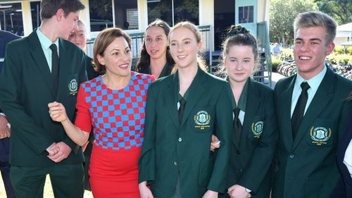 Jackie Trad with students at at Ferny Grove State High School in Brisbane. Picture: AAP