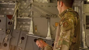 US Army Reserve, U.S. Airmen check their manifest for military equipment to be loaded onto a cargo plane as part of the deliberate withdrawal of forces from northern Syria at the Kobani Landing Zone.