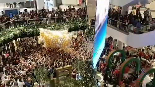 Westfield Parramatta Christmas promotion stampede injures several people