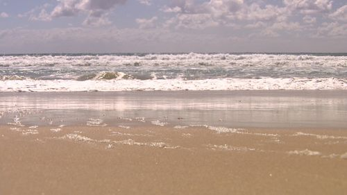 The baby's body was found on the shoreline of the Gold Coast beach.
