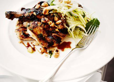 Grilled spatchcock with pear and cabbage salad, hazelnuts and sherry