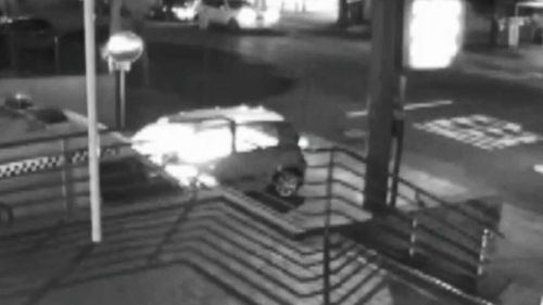 Security vision shows the moment the 63-year-old sets himself on fire inside his car. Picture: 9NEWS