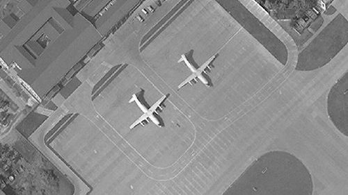 Satellite image of Woody Island in the Paracel island chain in the South China Sea taken in November, 2017, shows two Chinese Y-8 military transport aircraft. The Washington-based Asia Maritime Transparency Initiative says China has undertaken new deployments of military aircraft on the island in recent weeks. On other outposts in the disputed South China Sea has conducted major construction work during 2017. (AAP)