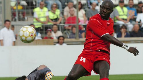 The former Liberian player George Weah , right, scores a goal during his jubilee soccer match played, in Marseille, southern France, Saturday 11, 2005. (AP Photo/Claude Paris)