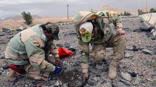 Engineers removing a landmine in Palmyra. (AAP)