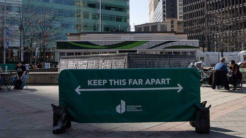 A sign enforcing coronavirus social distancing in Detroit, Michigan.