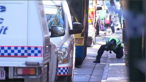 Witnesses said the woman was pinned under the bus front wheel. Image: 9News