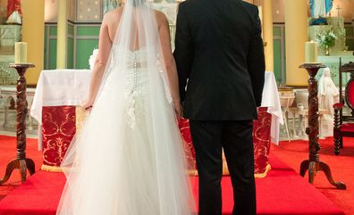 Bride and groom standing at altar