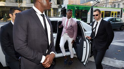Nelly Yoa arrives at the Melbourne Magistrates Court in Melbourne today.