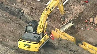 Worker dies after falling into trench
