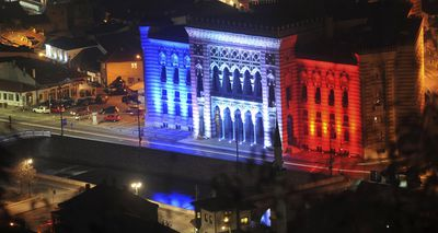 Sarajevo city hall is seen illuminated in the colours in Sarajevo, Bosnia. (AAP)