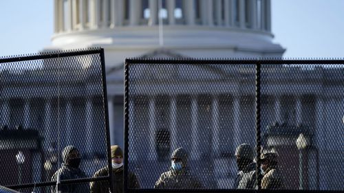 Barriers are erected around Capitol Hill following yesterday's riots.