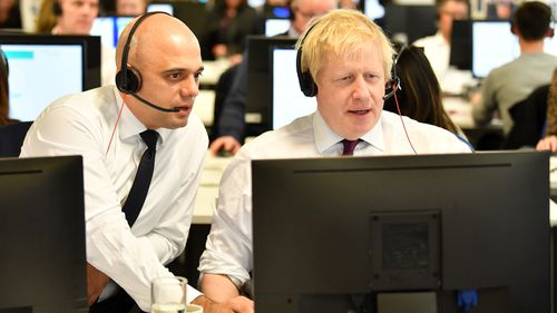 Chancellor of the Exchequer Sajid Javid and Boris Johnson man the phones at the Conservative Campaign Headquarters.