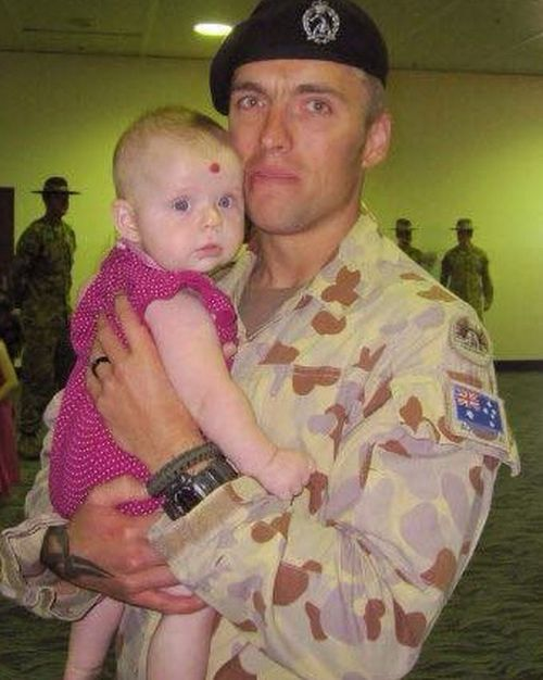 Matt Page, pictured with baby Willow, as he was preparing to to return to Afghanistan after a 10-day period of leave.