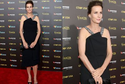 Although her high-fash frock was diamond-embellished, Rachel Griffiths cut a demure shape on the red carpet.<br/><br/>Think it might have something to do with that pose?